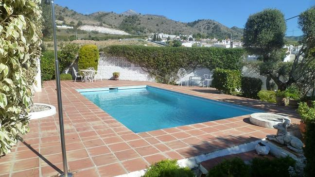 Large luxury villa for sale set in mature walled garden in Nerja, Málaga
